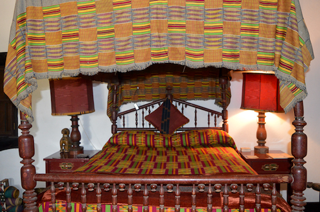Heritage house, Kenya - a bedroom adorned with kente cloth
