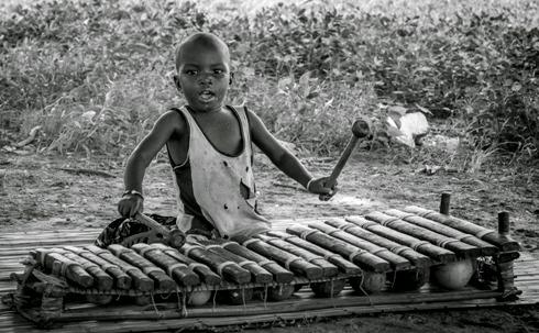 Child playing Balafon