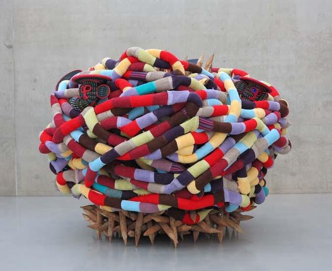 'Africonda', 2014 Pascale Tayou - cloth,mask,hay,wood