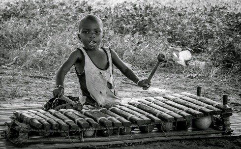 Child playing Balafon