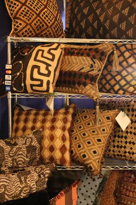 A display of one of a kind Kuba Cloth Pillows