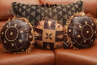 Giant Kuba Cloth Pillow and Vintage Leather Round Pillows