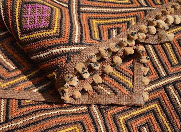 Kuba raffia cloth showing raffia stitching and bobbles