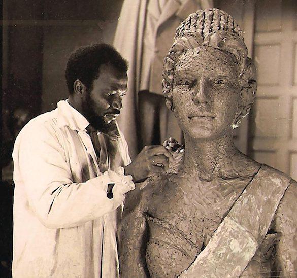 Enwonwu working on a bronze sculpture of Queen Elizabeth II.